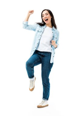 attractive and smiling asian woman in denim shirt showing yes gesture isolated on white