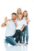 happy parents and kids waving hands and looking at camera on white