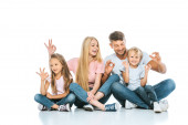 happy parents and kids showing ok sign on white
