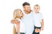 happy man hugging wife while holding in arms son isolated on white