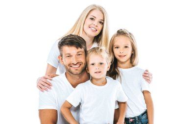 happy family in white t-shirts looking at camera and smiling isolated on white