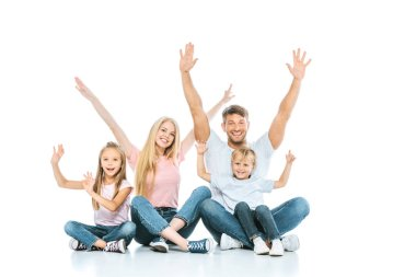 happy family with hands above heads smiling on white