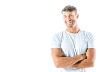cheerful man standing with crossed arms isolated on white