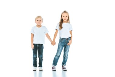 Cute kids holding hands and standing in blue jeans on white stock vector
