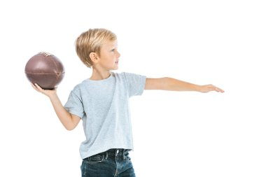 Side view of boy holding rugby ball isolated on white stock vector
