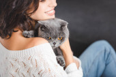 Fotografie close up of woman with grey scottish fold cat