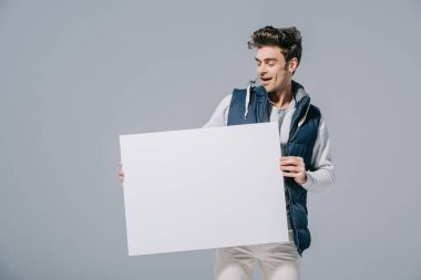Excited man in waistcoat posing with empty board, isolated on grey stock vector