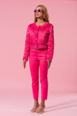 Fotografie trendy african american woman in sunglasses standing on pink background, fashion doll concept