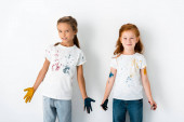 Fotografie cheerful kids with paint on hands standing on white