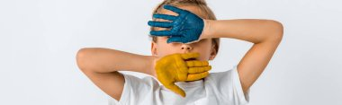 Panoramic shot of kid with paint on hands covering face isolated on white stock vector