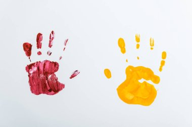 Red and yellow hand prints on white stock vector