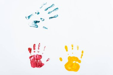 Red, blue and yellow hand prints on white stock vector