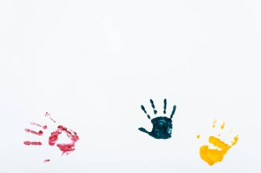 Blue, red and yellow hand prints on white stock vector