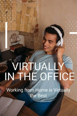 smiling mixed race man touching headphones near virtually in the office, working from home is virtually the best lettering