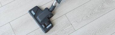 Panoramic shot of brush of vacuum cleaner on floor stock vector