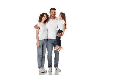 happy father holding in arms cute daughter and hugging curly wife on white