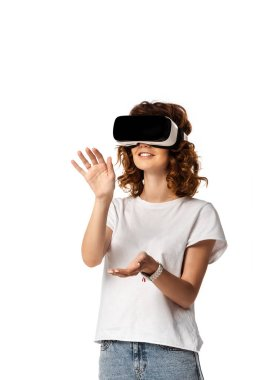 Happy young woman in virtual reality headset gesturing isolated on white stock vector