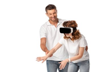 Happy man looking at woman in virtual reality headset gesturing isolated on white stock vector