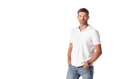 Handsome man in white t-shirt standing with hands in pockets isolated on white stock vector