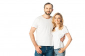 cheerful adult couple in white t-shirts embracing isolated on white