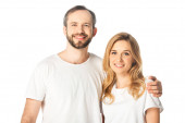 happy adult couple in white t-shirts embracing isolated on white