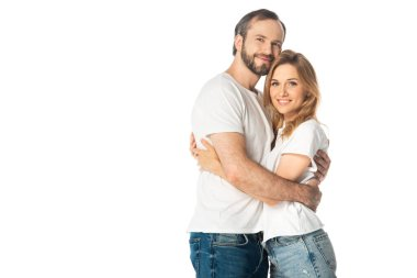 Happy adult couple in white t-shirts embracing isolated on white stock vector