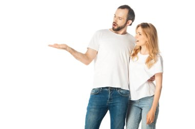 Adult couple in white t-shirts pointing with hand aside isolated on white stock vector