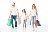 Fotografie fröhliche Familienwanderung mit bunten Einkaufstüten und Händchen haltend auf weißem Grund