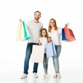 veselá rodina s barevné nákupní tašky izolované na bílém