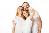 happy family in white t-shirts taking selfie on smartphone isolated on white