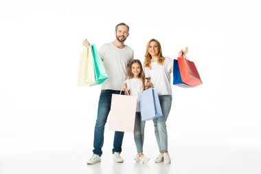 cheerful family with colorful shopping bags isolated on white