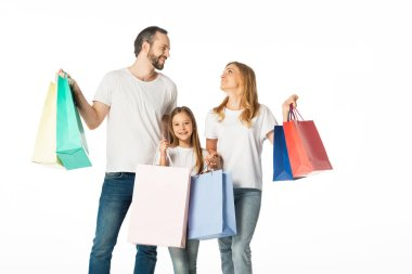 Cheerful family with colorful shopping bags isolated on white stock vector
