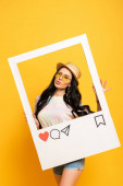 brunette girl in summer outfit posing pouting lips in social network frame on yellow background