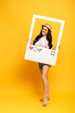 Smiling brunette girl in summer outfit posing in social network frame on yellow background stock vector