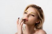 Photo beautiful blonde woman with wildflowers on eyebrows touching lips isolated on white