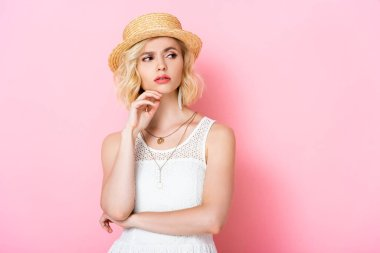 Thoughtful young woman in straw hat looking away on pink stock vector
