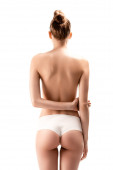 back view of woman in panties standing with arms behind back isolated on white