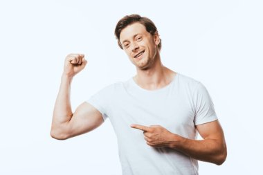 Young man pointing with finger at muscles on hand isolated on white stock vector
