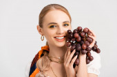 rustic blonde woman posing with grapes isolated on white
