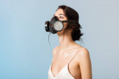 Photo brunette woman in gas mask looking up isolated on grey, ecology concept