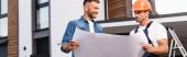 Horizontal concept of man holding blueprint near builder in uniform outdoors