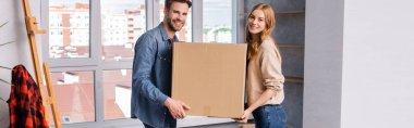 Panoramic shot of man and woman holding carton box, moving concept stock vector