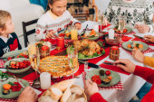 Selective focus of festive table with thanksgiving dinner and family at home