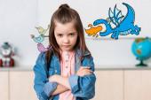 Fotografie Serious schoolgirl looking at camera near birds and dinosaur illustration