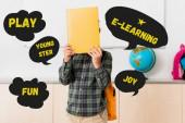 Schüler halten Buch in der Nähe von Gesicht und Spiel, Youngster und E-Learning-Illustration