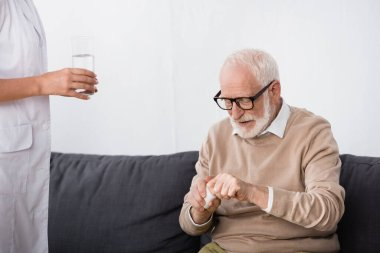 Aged man holding pills while medical assistant glass of water stock vector