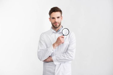 Front view of ophthalmologist in white coat with loupe looking at camera isolated on white stock vector