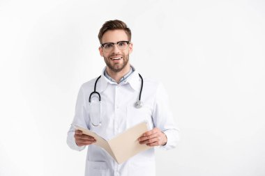 Front view of smiling young adult doctor with stethoscope holding folder isolated on white stock vector