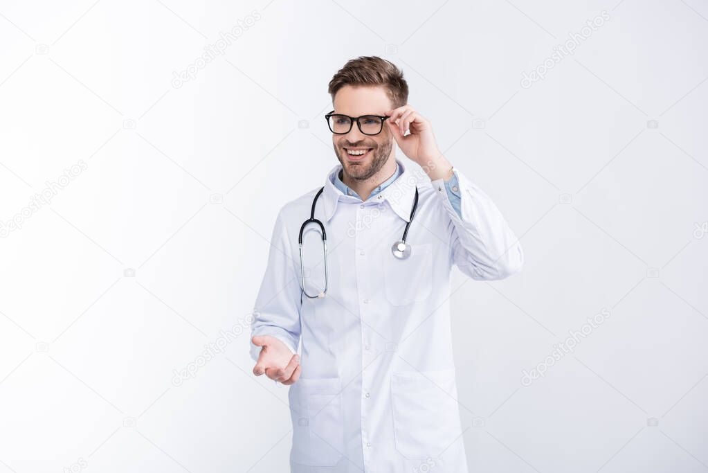 Happy doctor with stethoscope, holding eyeglasses frame, gesturing isolated on white stock vector