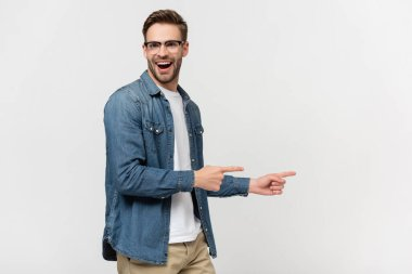 Cheerful man in eyeglasses pointing with fingers isolated on grey stock vector